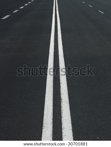 Road with white lines - stock photo