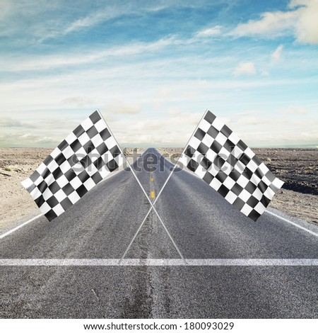 road with yellow arrow with Two Checker Flags Crossed - stock photo