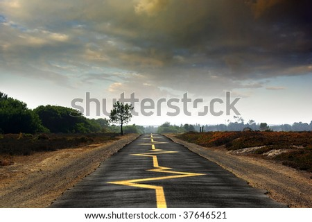 Road with yellow heartbeat monitoring signs - drive safely concept - stock photo