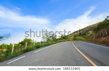 Road with yellow line on hills