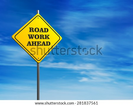 Road Work Ahead Sign against blue sky - stock photo