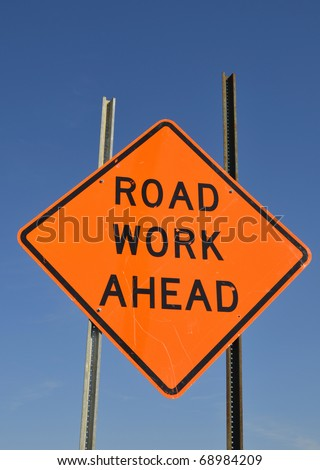 Road work ahead warning sign - stock photo