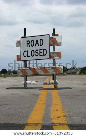 Road work sign indicating a road is closed. Taken in vertical format. - stock photo