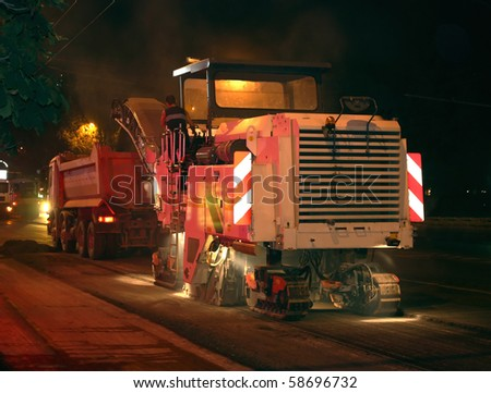 road works, removal of old asphalt pavement - stock photo