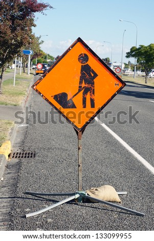 Road works sign used to warn drivers of construction ahead - stock photo
