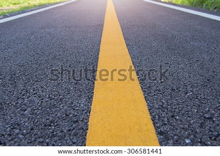 roadbackground,Highway surface with two yellow lines. Asphalt backdrop