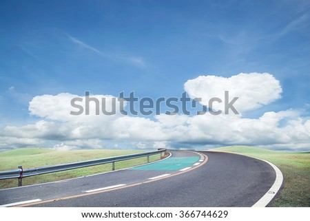 Roads and green grass Sky background - stock photo