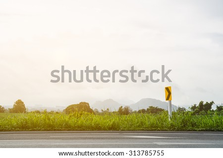 Roads, meadows and traffic signs. - stock photo