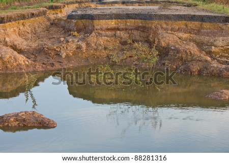 Roads with water erosion. Roads were cut off by water erosion, Views of the countryside. - stock photo