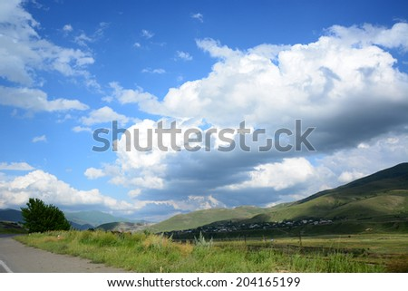 Roadside landscape with dramatic sky - stock photo