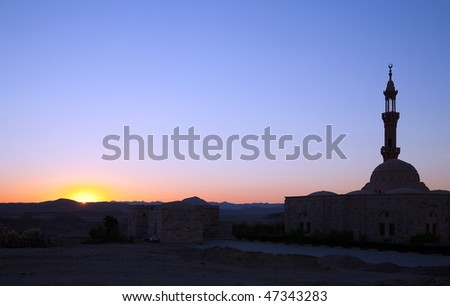 Roadside mosque in the Egyptian desert during sunset