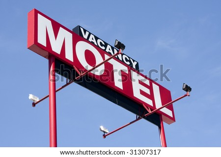 Roadside motel sign with vacancy on the top - stock photo