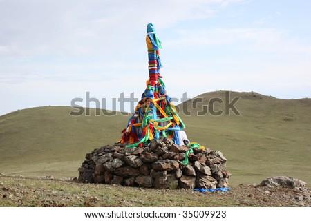 Roadside Ovoo Shaman Shrine, Gobi Desert, Mongolia - stock photo