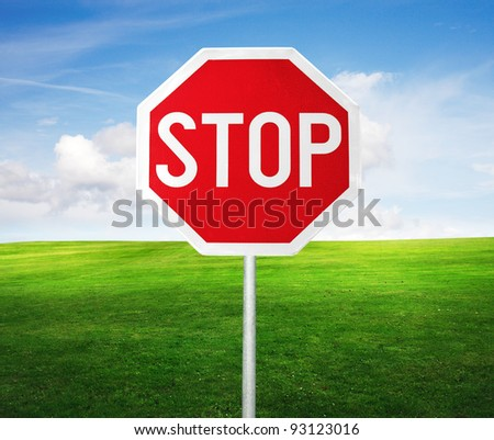 roadside red stop sign in outdoor - stock photo