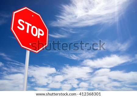 Roadside Red Stop Sign on a Cloudy Background