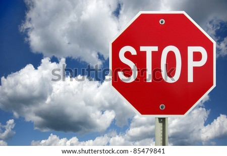 roadside red stop sign on a cloudy background. Sign isolated.
