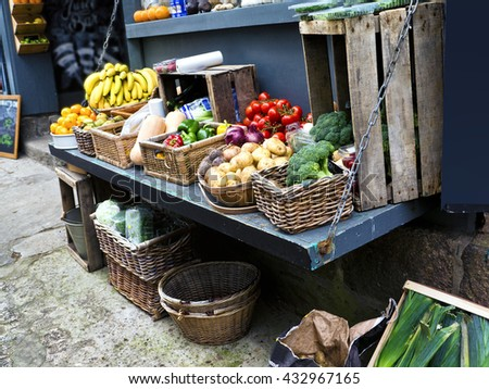 Roadside vegetable display;  fruit and vegetables displayed outside small greengrocery store  - stock photo