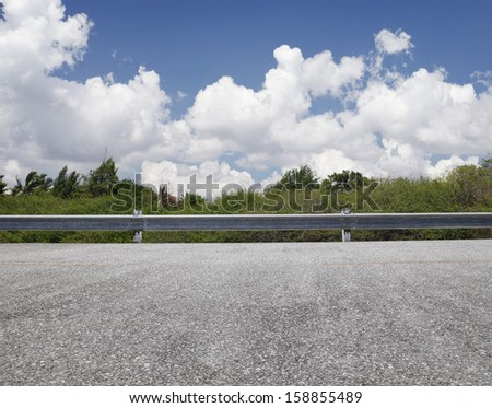 Roadside view, blue sky - stock photo