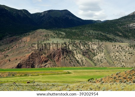 Roadside view of a farm and river valley along the highway 1, british columbia, canada - stock photo