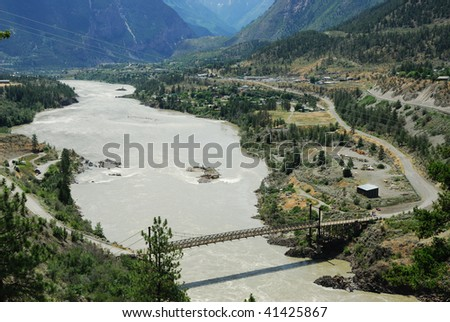 Roadside view of a river valley, small town lillooet and the surrounding mountains, lillooet, british columbia, canada