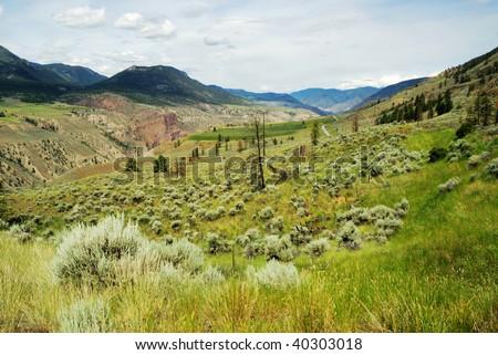 Roadside view of the desert-like barren terrain along the highway 1, british columbia, canada - stock photo