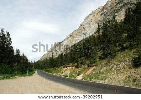 Roadside view of the rocky cliffs and forest along the highway 1, british columbia, canada - stock photo