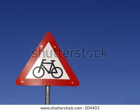 Roadsign - cyclist ahead on a clear bule sky - stock photo
