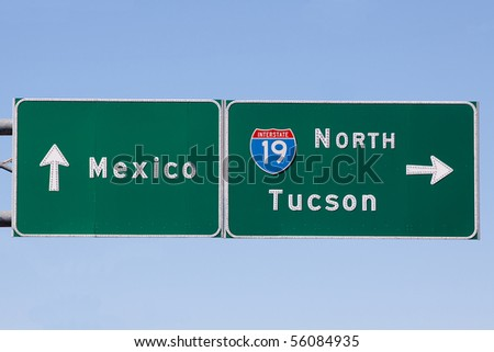 Roadsign pointing between Nogales, mexico and Tucson, Arizona - stock photo