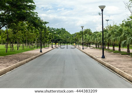 roadway in big park or walkway in garden at bangkok,Thailand - stock photo