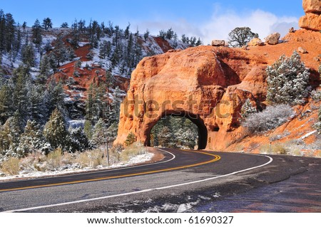 Roadway tunnel carved through solid rock in Utah's Zion National Park - stock photo