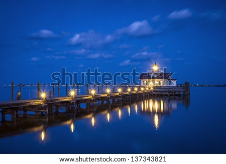 Roanoke Marshes Lighthouse Manteo NC Outer Banks North Carolina dock in Albemarle Sound - stock photo