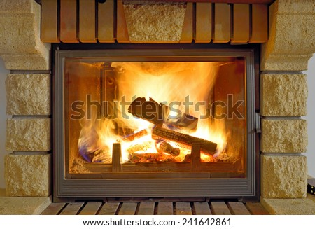 Roaring flames in a modern fireplace