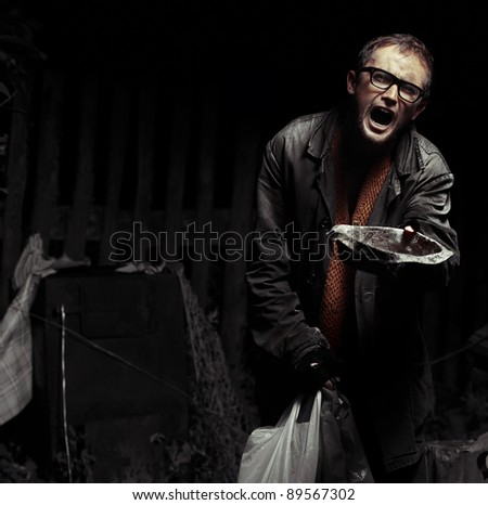 Roaring man in tramp's dirty wears looking to a camera and asking help with dish - stock photo