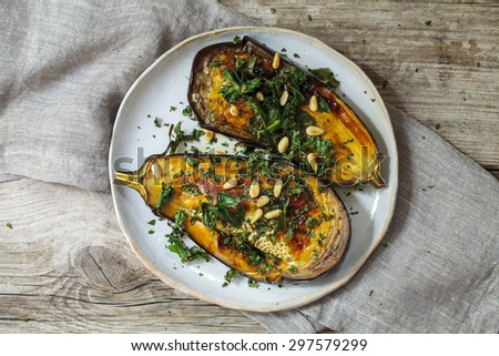 Roast aubergine with crispy kale and pine nuts