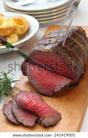 roast beef carving, sunday dinner - stock photo