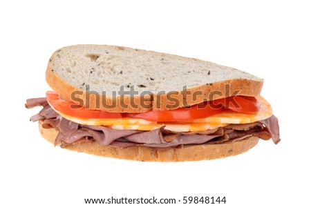 Roast beef, cheese and tomato on rye bread sandwich isolated on white