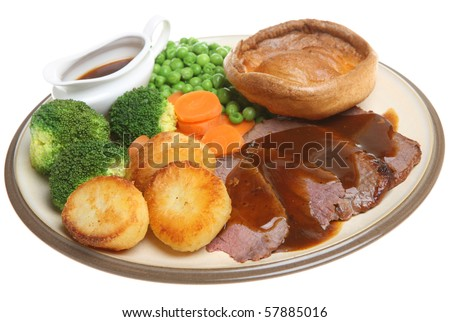 Roast beef dinner with Yorkshire pudding.