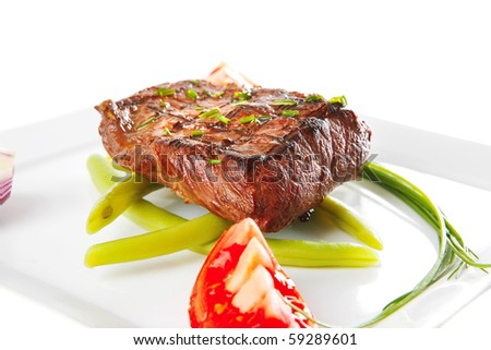 roast beef fillet served with tomato on white - stock photo