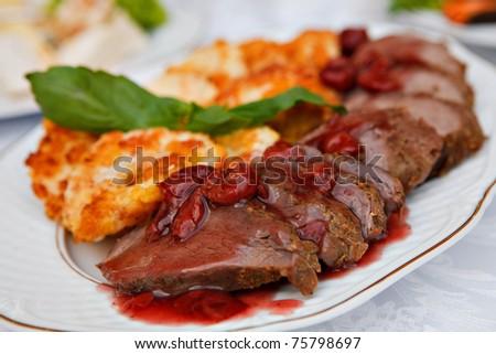 roast beef in a cherry sauce - stock photo