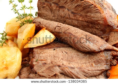 Roast beef joint and carved on white - stock photo