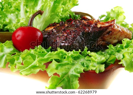 roast beef meat on green salad over white - stock photo