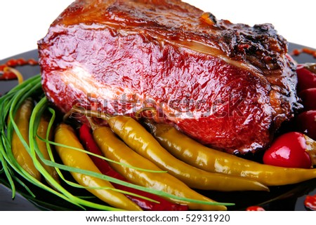 roast beef meat served on black palate with peppers - stock photo