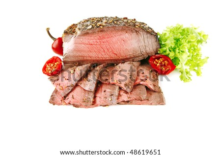 roast beef meat slice with red hot pepper - stock photo
