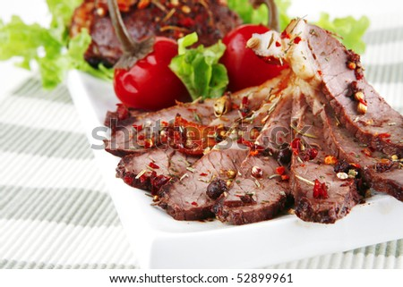 roast beef meat slices on ceramic plate - stock photo
