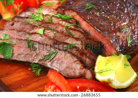 roast beef meat slices served on wood tray - stock photo