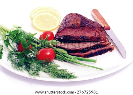 roast beef meat steak chunk with asparagus dill and cherry tomatoes on white plate - stock photo