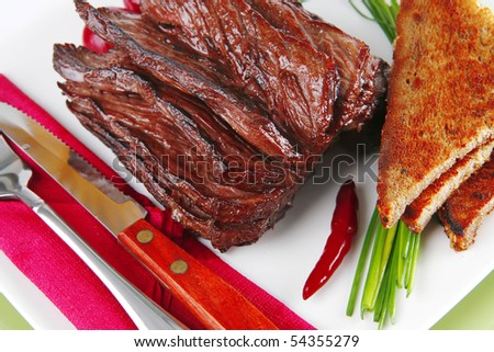 roast beef meat with dishware over white - stock photo
