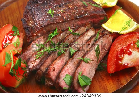 roast beef meat with tomato and lemon - stock photo