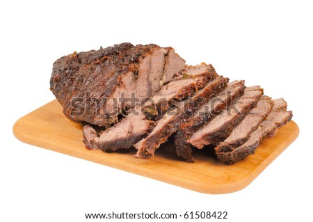 Roast beef on a wooden board. Isolated on white. - stock photo