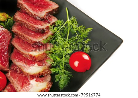 roast beef on dark with fennel and tomatoes - stock photo